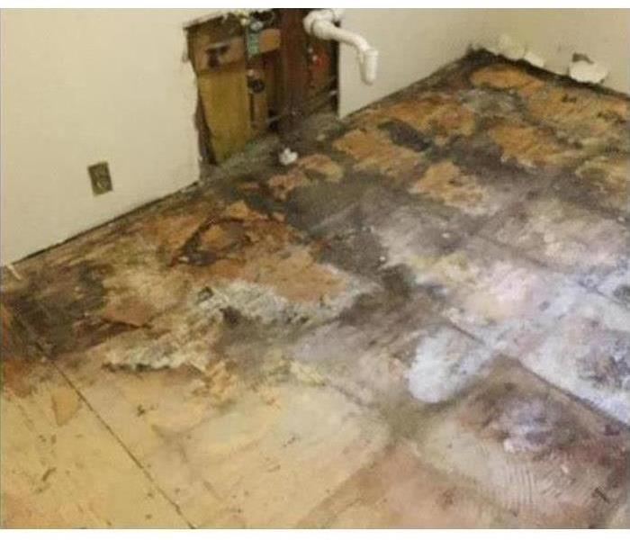 flooring is discolored from a water leak, flooring had to be removed